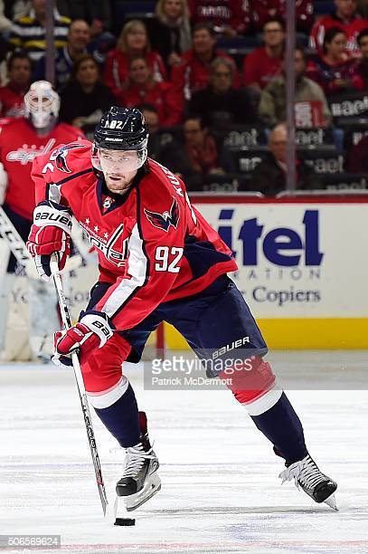 Evgeny Kuznetsov of the Washington Capitals controls the puck against the Vancouver Canucks in the third period during an NHL game at Verizon Center...