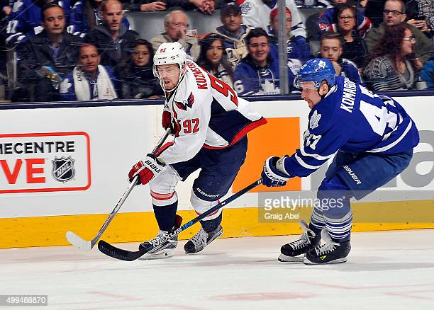 Evgeny Kuznetsov of the Washington Capitals gets by Leo Komarov of the Toronto Maple Leafs during game action on November 28 2015 at Air Canada...