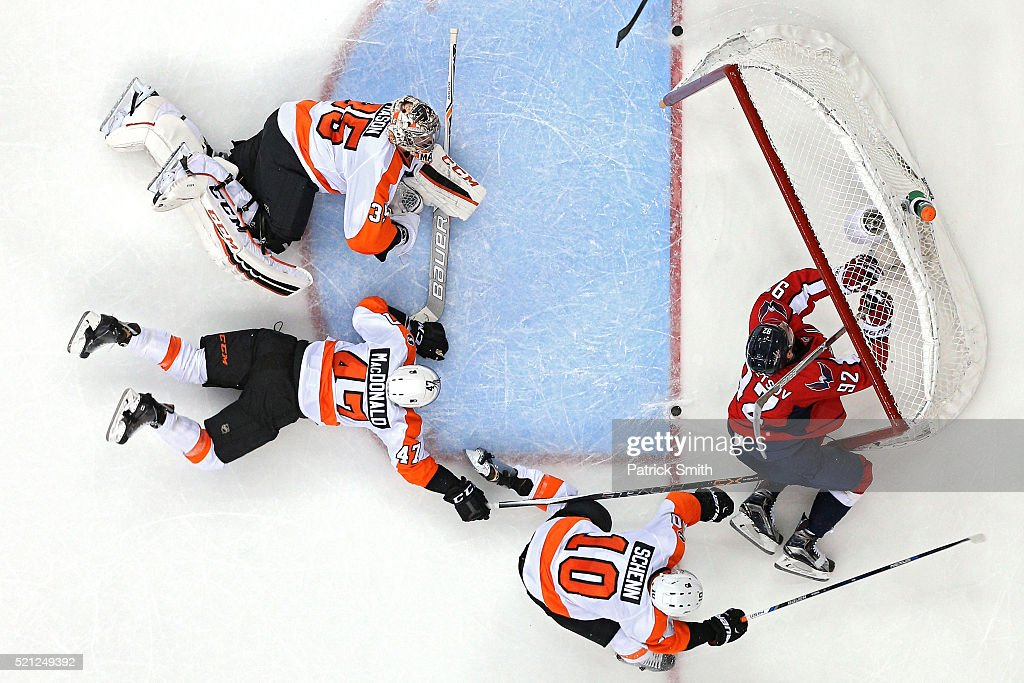 Evgeny Kuznetsov #92 of the Washington Capitals is checked into the goal by Brayden Schenn #10 of the Philadelphia Flyers during the third period in Game One of the Eastern Conference Quarterfinals during the 2015 NHL Stanley Cup Playoffs at Verizon Center on April 14, 2016 in Washington, DC. The Washington Capitals won, 2-0.