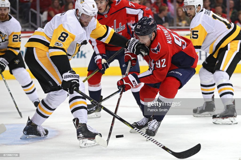 Evgeny Kuznetsov #92 of the Washington Capitals is defended by Brian Dumoulin #8 of the Pittsburgh Penguins during the second period at Capital One Arena on November 10, 2017 in Washington, DC.