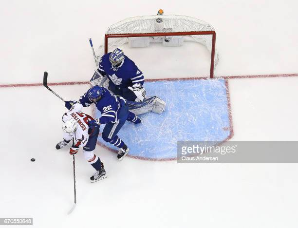 Evgeny Kuznetsov of the Washington Capitals is guarded by Nikita Zaitsev of the Toronto Maple Leafs in Game Three of the Eastern Conference...