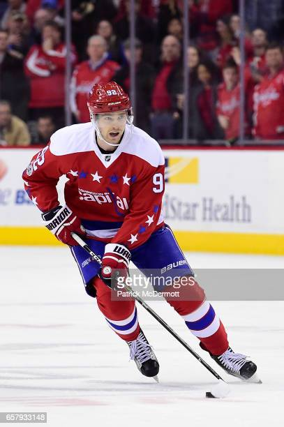 Evgeny Kuznetsov of the Washington Capitals prepares to take a shot against the Columbus Blue Jackets in a shootout during an NHL game at Verizon...