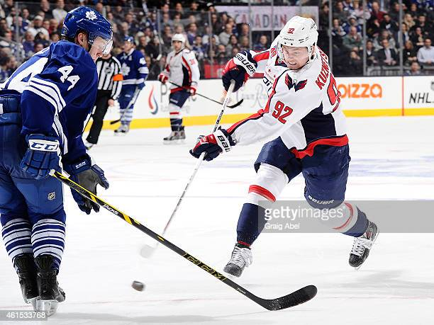 Evgeny Kuznetsov of the Washington Capitals shoots the puck past Morgan Rielly of the Toronto Maple Leafs during game action against the Toronto...