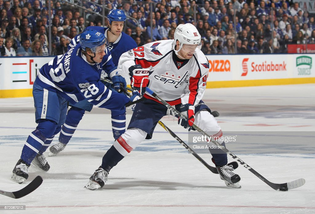 Evgeny Kuznetsov #92 of the Washington Capitals skates against Kasperi Kapanen #28 of the Toronto Maple Leafs in Game Six of the Eastern Conference Quarterfinals during the 2017 NHL Stanley Cup Playoffs at the Air Canada Centre on April 23, 2017 in Toronto, Ontario, Canada. The Capitals defeated the Maple Leafs 2-1 in overtime to win series 4-2.