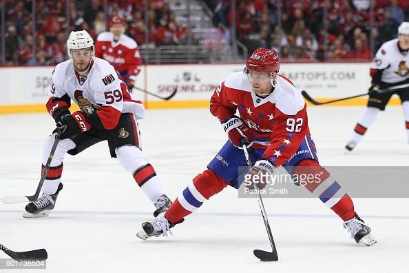 Evgeny Kuznetsov of the Washington Capitals skates past David Dziurzynski of the Ottawa Senators at Verizon Center on December 16 2015 in Washington...