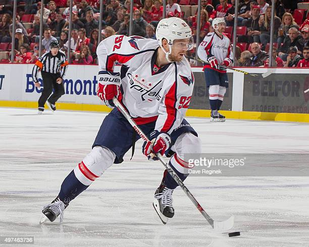 Evgeny Kuznetsov of the Washington Capitals skates up ice with the puck during an NHL game against the Detroit Red Wings at Joe Louis Arena on...