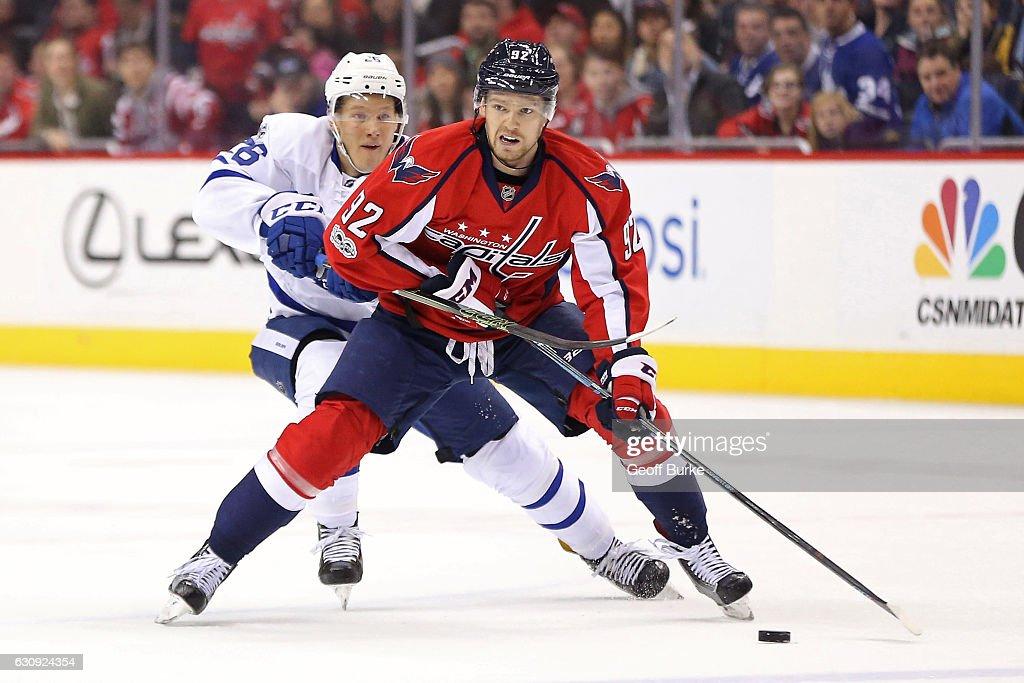 Evgeny Kuznetsov #92 of the Washington Capitals skates with the puck as Nikita Soshnikov #26 of the Toronto Maple Leafs chases in the third period at Verizon Center on January 3, 2017 in Washington, DC.
