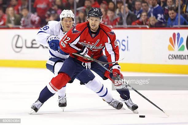 Evgeny Kuznetsov of the Washington Capitals skates with the puck as Nikita Soshnikov of the Toronto Maple Leafs chases in the third period at Verizon...