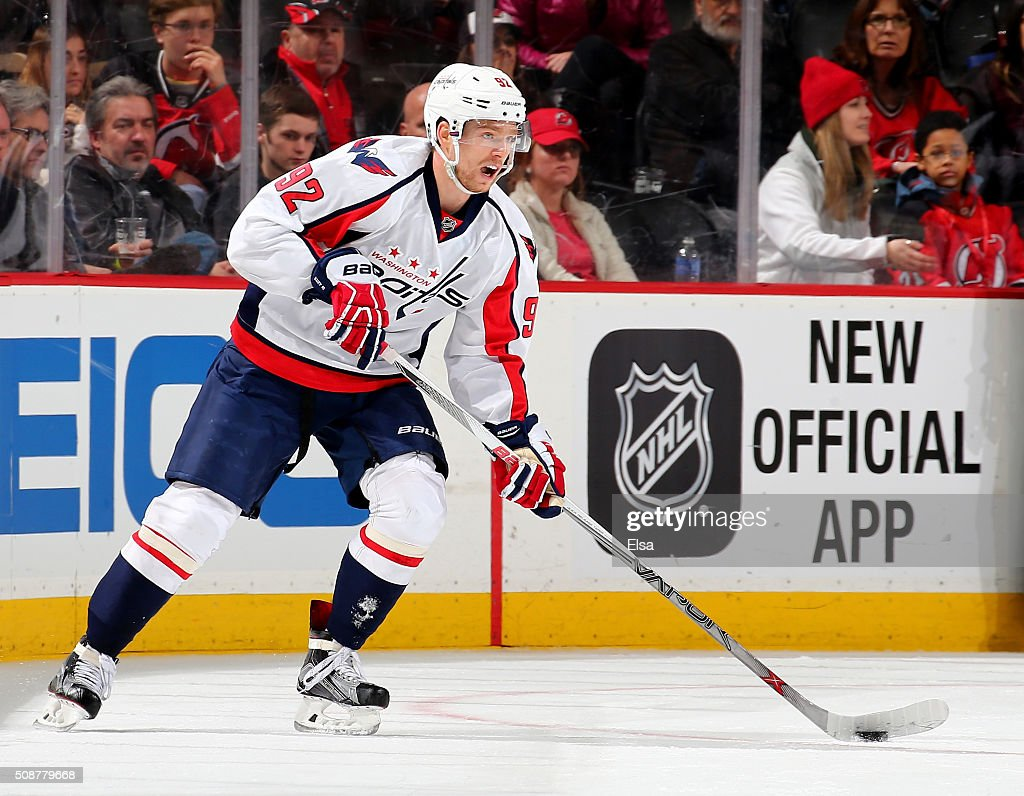 <a gi-track='captionPersonalityLinkClicked' href=/galleries/search?phrase=Evgeny+Kuznetsov+-+Ice+Hockey+Player&family=editorial&specificpeople=9684626 ng-click='$event.stopPropagation()'>Evgeny Kuznetsov</a> #92 of the Washington Capitals takes the puck in the third period against the New Jersey Devils on February 6, 2016 at Prudential Center in Newark, New Jersey.The Washington Capitals defeated the New Jersey Devils 3-2 in an overtime shootout.