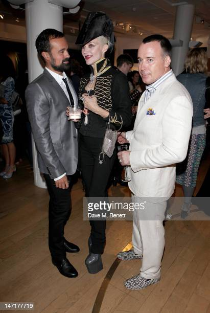 Evgeny Lebedev Daphne Guinness and David Furnish attend a charity auction for the Daphne Guinness Collection being sold to benefit the Isabella Blow...