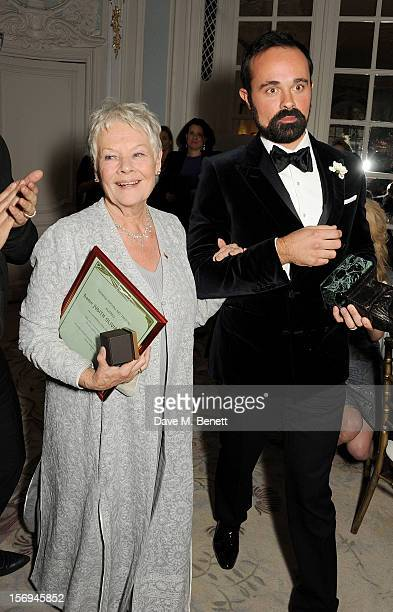 Evgeny Lebedev walks Dame Judi Dench to the stage to collect the Moscow Art Theatre's Golden Seagull award at the 58th London Evening Standard...