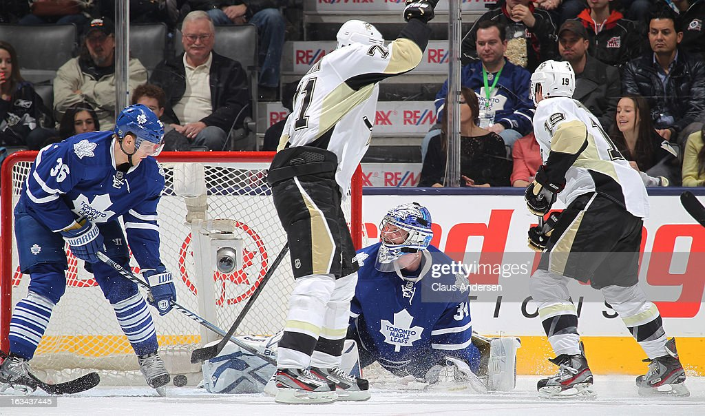 Evgeny Malkin #71 of the Pittsburgh Penguins slips a puck past James Reimer #34 of the Toronto Maple Leafs in a game on March 9, 2013 at the Air Canada Centre in Toronto, Ontario, Canada.