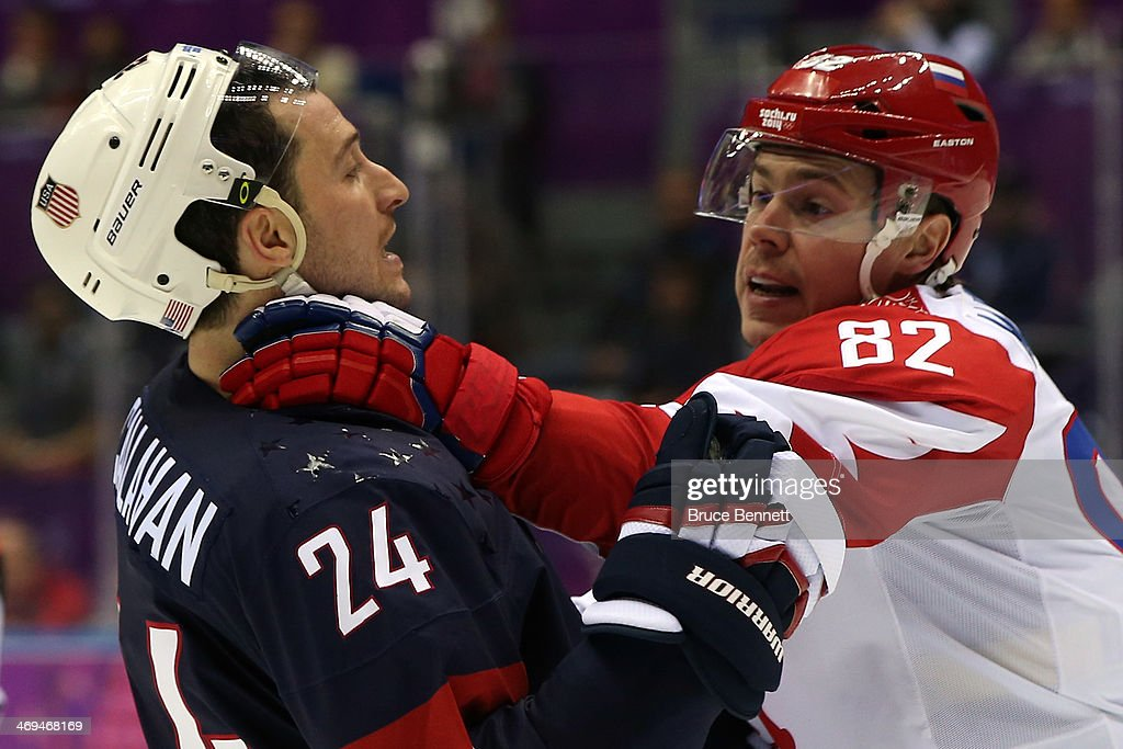 Evgeny Medvedev #82 of Russia fights with <a gi-track='captionPersonalityLinkClicked' href=/galleries/search?phrase=Ryan+Callahan&family=editorial&specificpeople=809690 ng-click='$event.stopPropagation()'>Ryan Callahan</a> #24 of United States during the Men's Ice Hockey Preliminary Round Group A game on day eight of the Sochi 2014 Winter Olympics at Bolshoy Ice Dome on February 15, 2014 in Sochi, Russia.