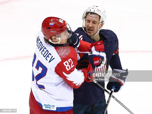 Evgeny Medvedev of Russia fights with Ryan Callahan of United States during the Men's Ice Hockey Preliminary Round Group A game on day eight of the...