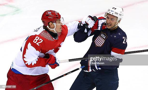 Evgeny Medvedev of Russia punches Ryan Callahan of United States during the Men's Ice Hockey Preliminary Round Group A game on day eight of the Sochi...