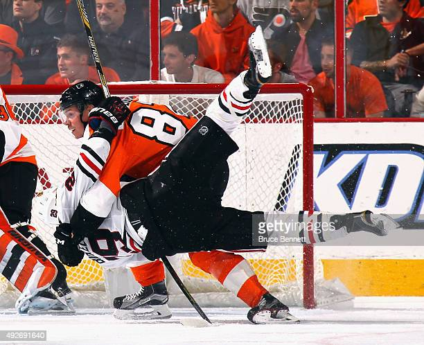 Evgeny Medvedev of the Philadelphia Flyers wrestles with Bryan Bickell of the Chicago Blackhawks during the second period at the Wells Fargo Center...