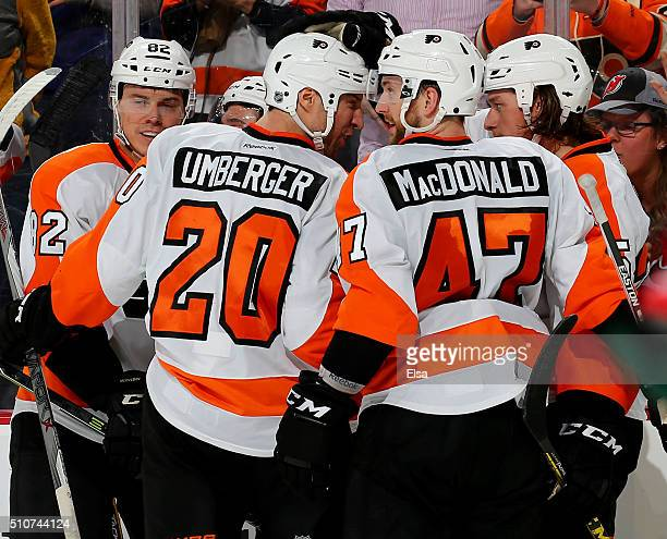 Evgeny MedvedevRJ Umberger and Andrew MacDonald of the Philadelphia Flyers congratulate Ryan White after he scored in the third period against the...