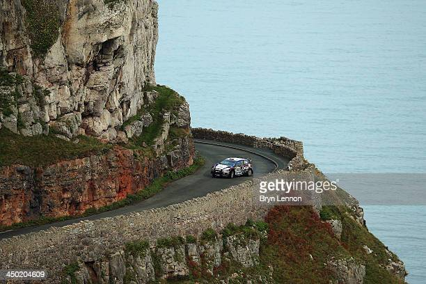 Evgeny Novikov of Russia and Ilka Minor of Austria compete in their Qatar MSport WRT Ford Fiesta RS WRC on the Great Orme Stage of the FIA World...