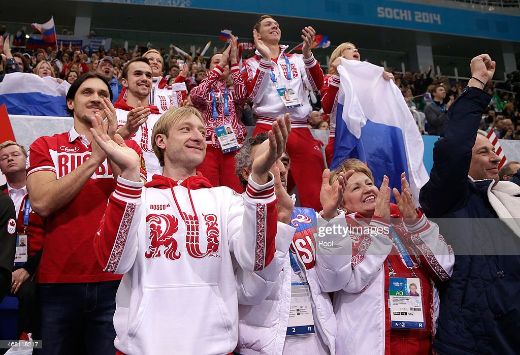 Evgeny Plyushchenko of Russia (front L) cheers with teammates as Yulia Lipnitskaya competes in the Team Ladies Free Skating during day two of the Sochi 2014 Winter Olympics at Iceberg Skating Palace onon February 9, 2014 in Sochi, Russia.