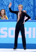 Evgeny Plyushchenko of Russia waves to fans after withdrawing from the competition after warming up during the Men's Figure Skating Short Program on...