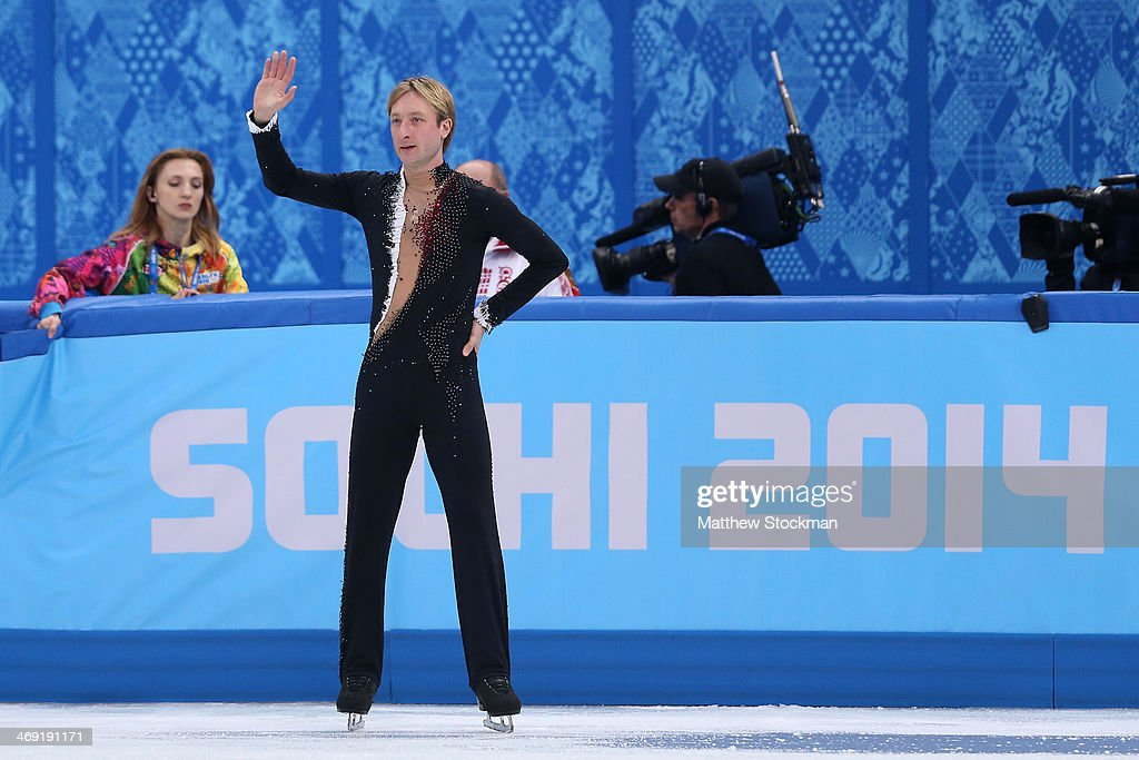 Evgeny Plyushchenko of Russia waves to fans as he withdraws from the competition after warm up during the Men's Figure Skating Short Program on day 6 of the Sochi 2014 Winter Olympics at the at Iceberg Skating Palace on February 13, 2014 in Sochi, Russia.