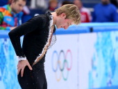 Evgeny Plyushchenko of Russia withdraws from the competition after warming up due to injury during the Men's Figure Skating Short Program on day 6 of...