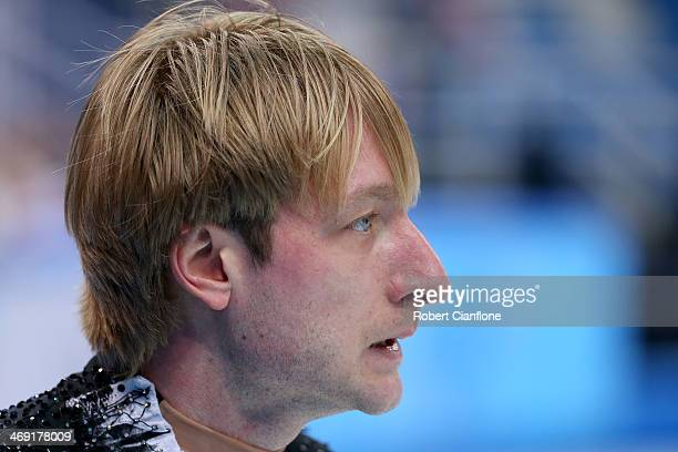 Evgeny Plyushchenko of Russia withdraws from the competition after warming up during the Men's Figure Skating Short Program on day 6 of the Sochi...