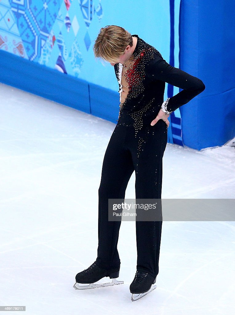 Evgeny Plyushchenko of Russia withdraws from the competition after warming up during the Men's Figure Skating Short Program on day 6 of the Sochi 2014 Winter Olympics at the at Iceberg Skating Palace on February 13, 2014 in Sochi, Russia.