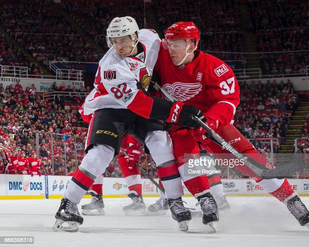 Evgeny Svechnikov of the Detroit Red Wings battles for position with Colin White of the Ottawa Senators during an NHL game at Joe Louis Arena on...