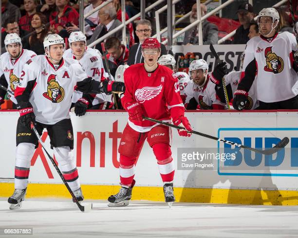 Evgeny Svechnikov of the Detroit Red Wings follows the play next to Dion Phaneuf of the Ottawa Senators during an NHL game at Joe Louis Arena on...