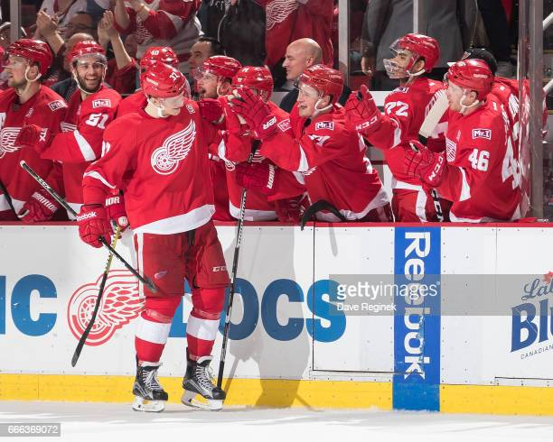 Evgeny Svechnikov of the Detroit Red Wings is congratulated by teammates on the bench following his shootout overtime goal during an NHL game against...