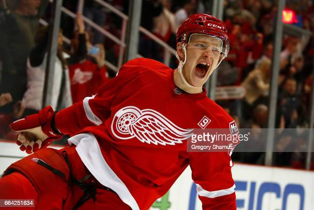 Evgeny Svechnikov of the Detroit Red Wings reacts to his game winning shoot out goal while playing the Ottawa Senators at Joe Louis Arena on April 3...