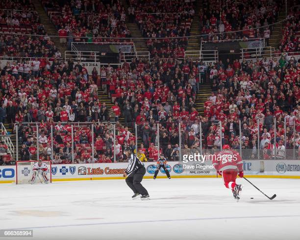 Evgeny Svechnikov of the Detroit Red Wings skates in for a shootout attempt on Craig Anderson of the Ottawa Senators during an NHL game at Joe Louis...