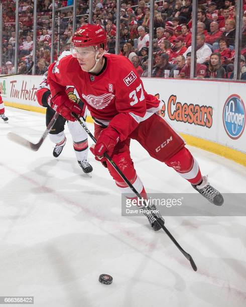 Evgeny Svechnikov of the Detroit Red Wings skates out of the corner with the puck during an NHL game against the Ottawa Senators at Joe Louis Arena...