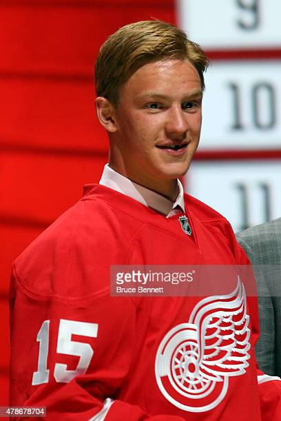 Evgeny Svechnikov poses after being selected 19th overall by the Detroit Red Wings in the first round of the 2015 NHL Draft at BBT Center on June 26...