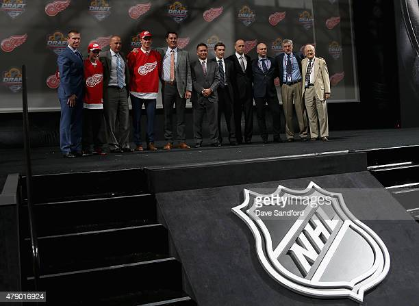 Evgeny Svechnikov poses for a group photo with members of the Detroit Red Wings organization after being selected 19th overall by the Detroit Red...