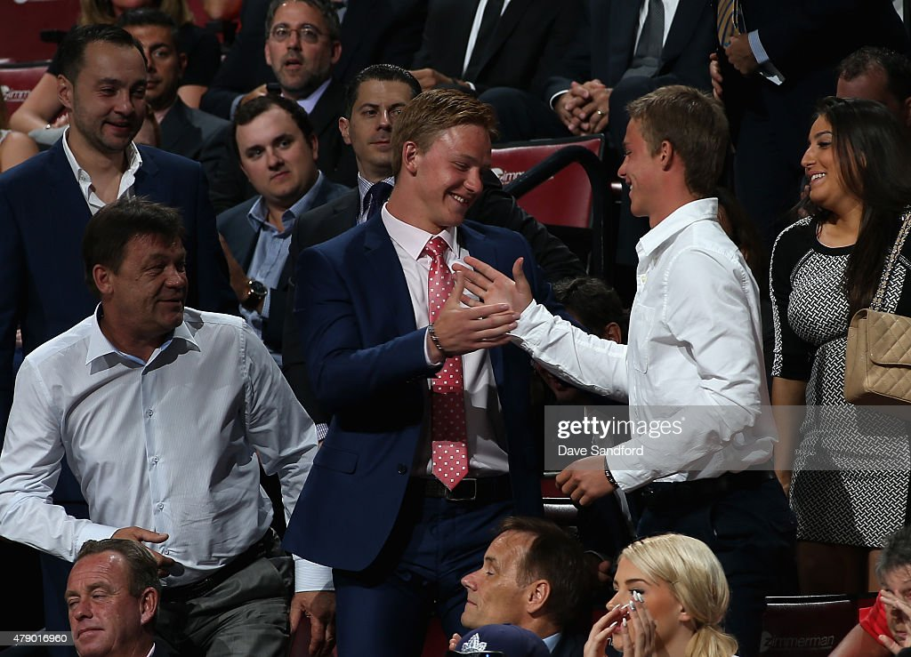 <a gi-track='captionPersonalityLinkClicked' href=/galleries/search?phrase=Evgeny+Svechnikov&family=editorial&specificpeople=8806917 ng-click='$event.stopPropagation()'>Evgeny Svechnikov</a> reacts after being selected 19th overall by the Detroit Red Wings during Round One of the 2015 NHL Draft at BB&T Center on June 26, 2015 in Sunrise, Florida.