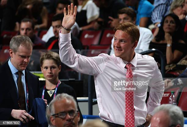 Evgeny Svechnikov waves to the crowd after being selected 19th overall by the Detroit Red Wings during Round One of the 2015 NHL Draft at BBT Center...
