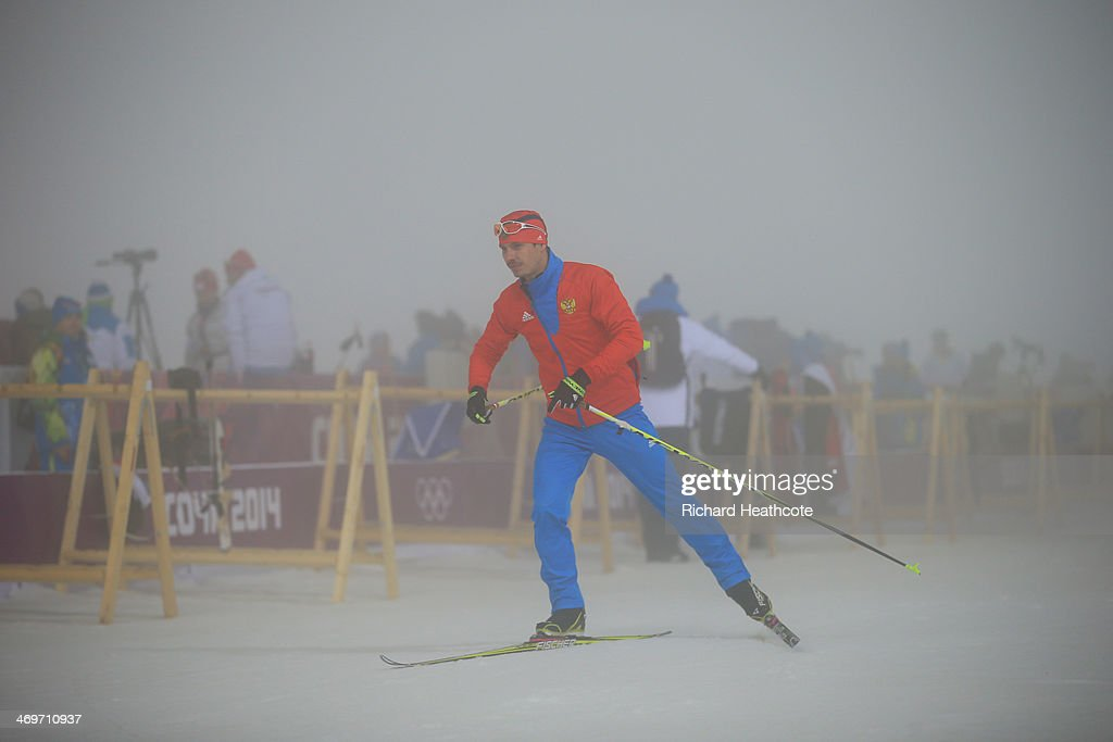 Evgeny Ustyugov of Russia passes the shooting range after the competition was postponed due to fog before the Men's 15 km Mass Start during day nine of the Sochi 2014 Winter Olympics at Laura Cross-country Ski & Biathlon Center on February 16, 2014 in Sochi, Russia.
