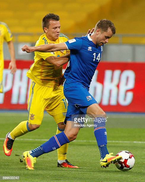 Evhen Konoplyanka of Ukrainian national team fights for the ball with Kari Arnason of Iceland national teamduring the qualifying round FIFA World Cup...