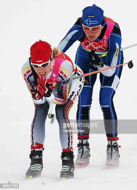 Evi Sachenbacher Stehle of Germany and Virpi Kuitunen of Finland compete in the Womens Cross Country Skiing 30km Mass Start Final on Day 14 of the...
