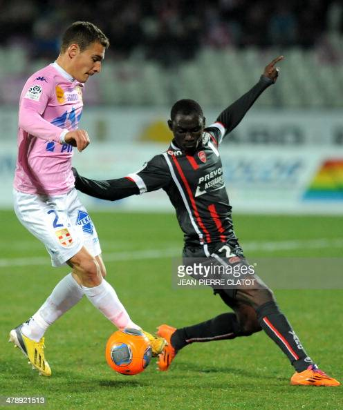Evian's Argentine forward Marco Ruben vies with Valenciennes' Senegalese defender Saliou Ciss during the French L1 football match EvianThonon vs...