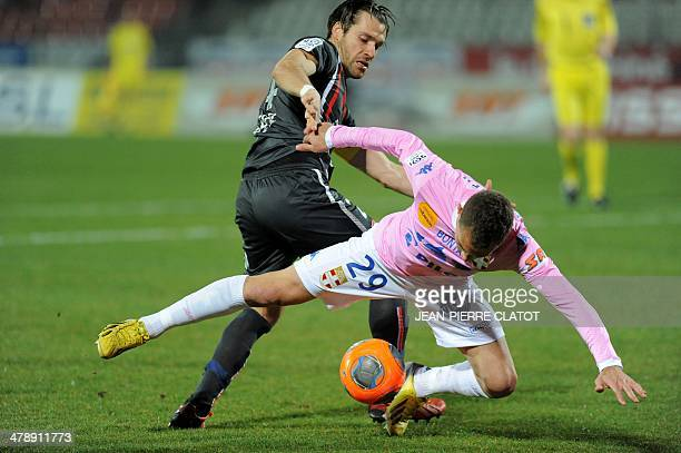 Evian's Argentine forward Marco Ruben vies with Valenciennes' Uruguayan defender Gary Kagelmacher during the French L1 football match EvianThonon vs...