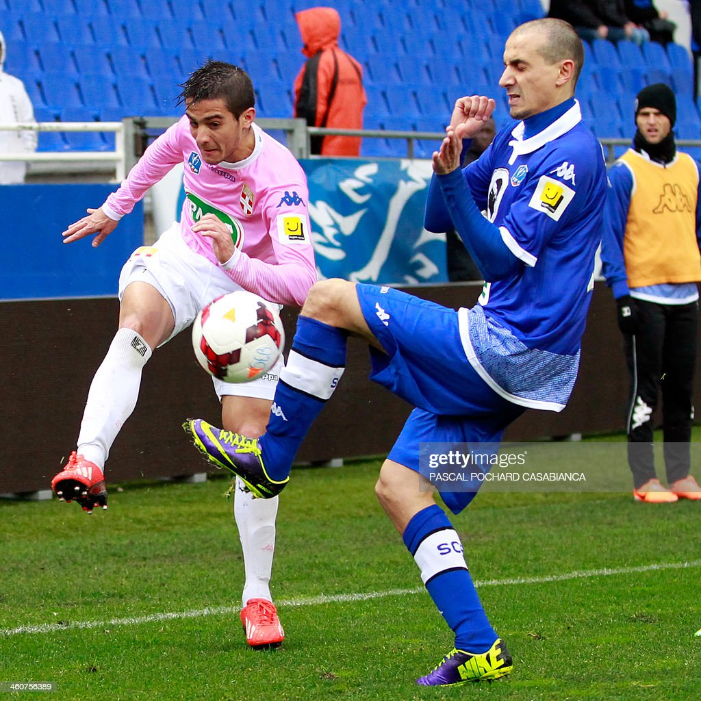 Evian's Argentinian midfielder Facundo Bertoglio vies with Bastia's Algerian defender Fethi Harek during the French Cup football match Bastia against...