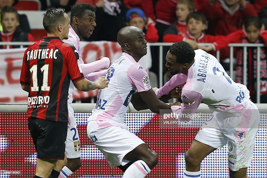Evian's Comorian defender Kassim Abdallah (R) reacts in front of Nice's French midfielder Eric Bautheac (L) during the French L1 football match between Nice and Evian Thonon on April 4, 2015 at the Allianz Riviera stadium in Nice, southeastern France.