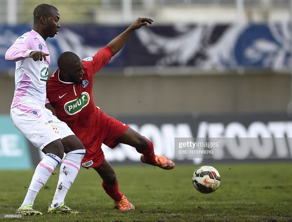 Evian's Congolese defender <a gi-track='captionPersonalityLinkClicked' href=/galleries/search?phrase=Cedric+Mongongu&family=editorial&specificpeople=4305033 ng-click='$event.stopPropagation()'>Cedric Mongongu</a> (L) fights for the ball during a French Cup round of 64 football match between Bobigny and Evian-TG on January 3, 2015 at the Auguste Delaune stadium in Saint-Denis.