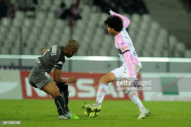 Evian's Costarician midfielder Yelksin Tejeda vies with Rennes' Swiss midfielder Gelson Fernandes during the French L1 football match Evian against...