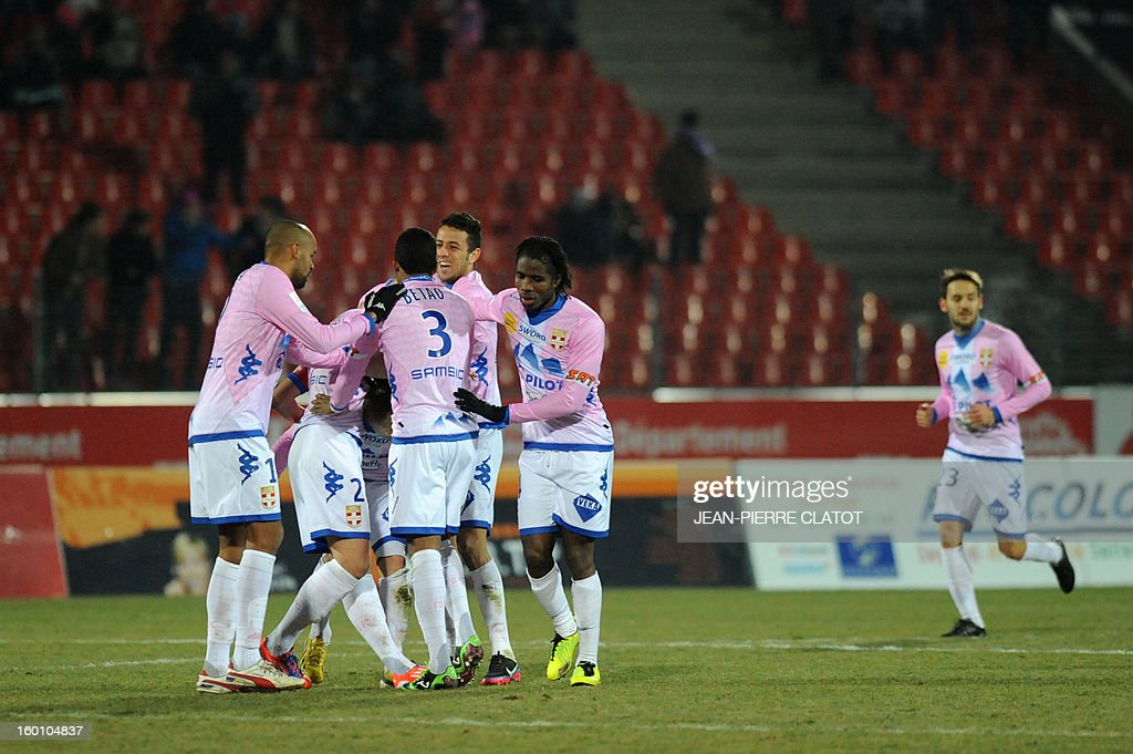 Evian's Danish defender Daniel Wass is congratulated by his teammates after scoring a goal during their French L1 football match Evian (ETGFC) vs Ajaccio (ACA) january 26 , 2013 at the city stadium Parc des sports in Annecy, eastern France. AFP PHOTO / JEAN-PIERRE CLATOT