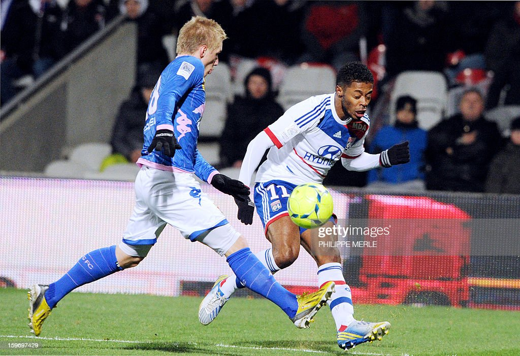 Evian's Danish defender Daniel Wass (L) vies for the ball with Lyon's Brazilian midfielder Michel Fernandes Bastos during the French L1 football match between Lyon and Evian on January 18, 2013, at the Gerland stadium in Lyon.