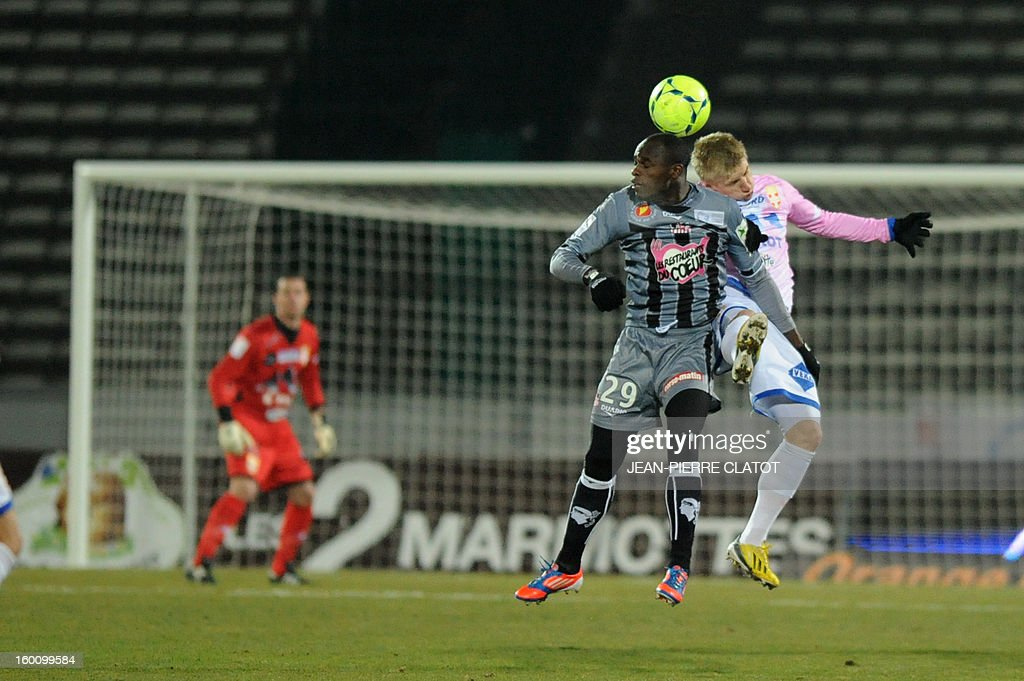 Evian's Danish defender Daniel Wass (R) vies with Ajaccio's Kenian forward Dennis Oliech during the French L1 football match Evian (ETGFC) vs Ajaccio (ACA) on January 26, 2013 at the city stadium Parc des sports in Annecy, eastern France.